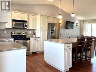 Photo 4: 255 Meadowbrook Drive E in Brooks: House for sale : MLS®# A1113573