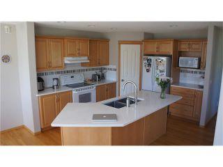 Photo 7: 100 TUSCANY RAVINE Road NW in Calgary: Tuscany House for sale : MLS®# C4030985