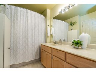 """Photo 22: 106 19649 53 Avenue in Langley: Langley City Townhouse for sale in """"Huntsfield Green"""" : MLS®# R2595915"""