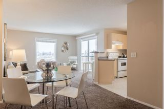 Photo 3: DOWNTOWN: Airdrie Apartment for sale