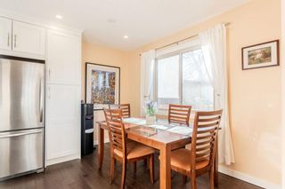 Photo 5: 1441 Ranchlands Road NW in Calgary: Ranchlands Row/Townhouse for sale : MLS®# A1061548