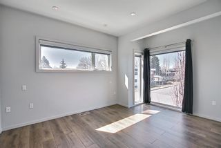 Photo 10: 158 23 Avenue NW in Calgary: Tuxedo Park Row/Townhouse for sale : MLS®# A1094441