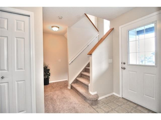 Photo 6: Photos: 606 EVERMEADOW Road SW in Calgary: Evergreen House for sale : MLS®# C4053479