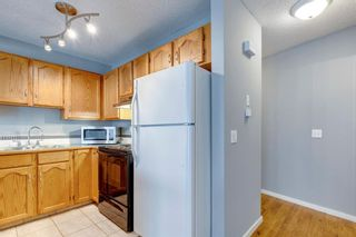 Photo 5: 57 Millview Green SW in Calgary: Millrise Row/Townhouse for sale : MLS®# A1135265