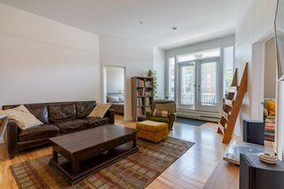 Photo 1: 209 1410 2 Street SW in Calgary: Beltline Apartment for sale : MLS®# A1130118