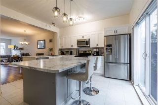 """Photo 15: 50 11067 BARNSTON VIEW Road in Pitt Meadows: South Meadows Townhouse for sale in """"COHO"""" : MLS®# R2472923"""
