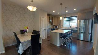 Photo 2: 110 Auburn Meadows Avenue SE in Calgary: Auburn Bay Semi Detached for sale : MLS®# A1095114
