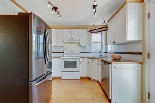 Photo 14: 322 Arbour Grove Close NW in Calgary: Arbour Lake Detached for sale : MLS®# A1115471