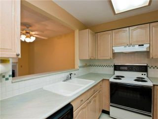 """Photo 5: # 420 6707 SOUTHPOINT DR in Burnaby: South Slope Condo for sale in """"Mission Woods"""" (Burnaby South)  : MLS®# V871813"""