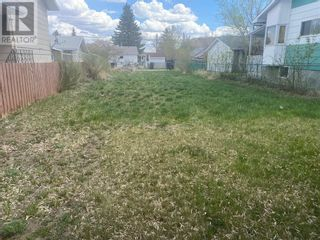 Photo 1: 712 2 Street SW in Drumheller: Vacant Land for sale : MLS®# A1100531