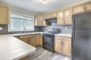 Photo 8: 516 Northmount Place NW in Calgary: Thorncliffe Detached for sale : MLS®# A1130678