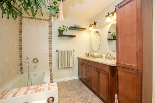 """Photo 14: 404 2733 ATLIN Place in Coquitlam: Coquitlam East Condo for sale in """"ATLIN COURT"""" : MLS®# R2232992"""