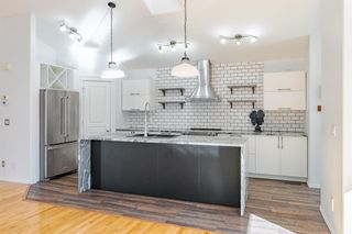 Photo 3: 48 West Springs Way SW in Calgary: West Springs Row/Townhouse for sale : MLS®# A1148807