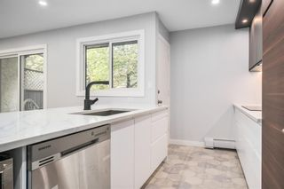 Photo 4: 822 3130 66 Avenue SW in Calgary: Lakeview Row/Townhouse for sale : MLS®# A1130272