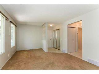 Photo 9: 115 PINESON Place NE in Calgary: Pineridge House for sale : MLS®# C4065261