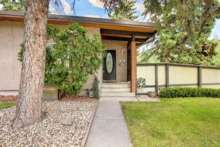 Photo 4: 702/704 53 Avenue SW in Calgary: Windsor Park Duplex for sale : MLS®# A1122930