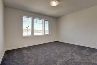 Photo 33: 136 Creekside Drive SW in Calgary: C-168 Semi Detached for sale : MLS®# A1108851