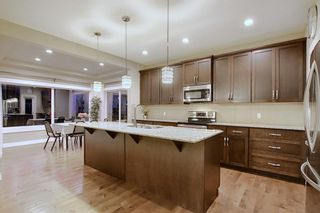 Photo 6: 1100 Brightoncrest Green SE in Calgary: New Brighton Detached for sale : MLS®# A1060195
