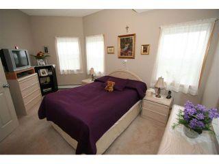 Photo 12: 314 72 QUIGLEY Drive: Cochrane Condo for sale : MLS®# C3477062
