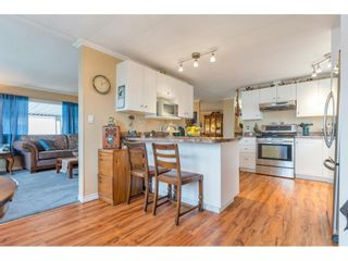 """Photo 10: 34 8254 134 Street in Surrey: Queen Mary Park Surrey Manufactured Home for sale in """"WESTWOOD ESTATES"""" : MLS®# R2586681"""