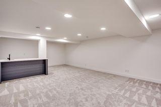 Photo 27: 7411 7 Street SW in Calgary: Kingsland Detached for sale : MLS®# A1021335