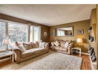 Photo 2: 869 QUEENSLAND Drive SE in CALGARY: Queensland Residential Attached for sale (Calgary)  : MLS®# C3616074