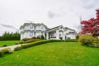 Photo 1: 7383 151A Street in Surrey: East Newton House for sale : MLS®# R2575342