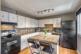 Photo 2: 48 23 Glamis Drive SW in Calgary: Glamorgan Row/Townhouse for sale : MLS®# A1099360