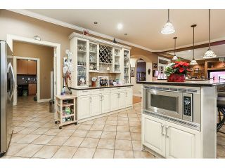 Photo 12: 15945 89A Avenue in Surrey: Fleetwood Tynehead House for sale : MLS®# R2016465