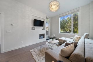 Photo 2: 103 119 19 Street NW in Calgary: West Hillhurst Apartment for sale : MLS®# A1116519