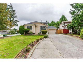 Photo 1: 6186 130 Street in Surrey: Panorama Ridge House for sale : MLS®# R2508593