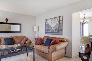 Photo 5: 203 DEERPOINT Lane SE in Calgary: Deer Ridge Row/Townhouse for sale : MLS®# C4288291
