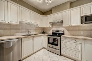Photo 5: 2201 LAKE FRASER Court SE in Calgary: Lake Bonavista Apartment for sale : MLS®# C4223049