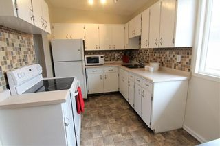 Photo 6: 524 34 Avenue NE in Calgary: Winston Heights/Mountview Semi Detached for sale : MLS®# A1078627