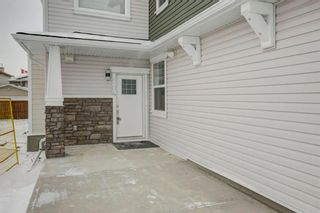 Photo 2: 302 115 Sagewood Drive: Airdrie Row/Townhouse for sale : MLS®# A1077282