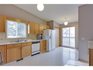 Photo 9: 75 LINCOLN Manor SW in Calgary: Lincoln Park House for sale : MLS®# C3654856