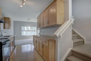 Photo 5: 76 Bridleridge Manor SW in Calgary: Bridlewood Row/Townhouse for sale : MLS®# A1106883