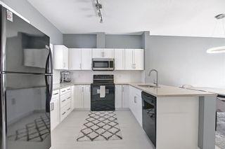 Photo 24: 504 281 Cougar Ridge Drive SW in Calgary: Cougar Ridge Row/Townhouse for sale : MLS®# A1123514