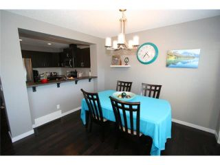 Photo 10: 225 SUNSET Common: Cochrane Residential Attached for sale : MLS®# C3590396