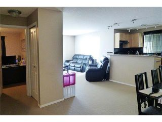 Photo 4: 2441 8 BRIDLECREST Drive SW in Calgary: Bridlewood Condo for sale : MLS®# C4084322