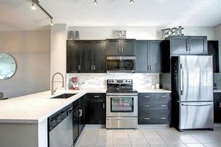 Photo 15: 1103 125 Panatella Way NW in Calgary: Panorama Hills Row/Townhouse for sale : MLS®# A1143179