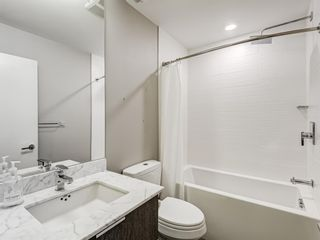 Photo 23: 216 823 5 Avenue NW in Calgary: Sunnyside Apartment for sale : MLS®# A1078604