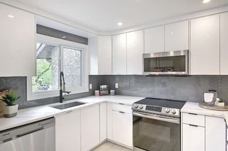 Photo 14: 64 Glamis Gardens SW in Calgary: Glamorgan Row/Townhouse for sale : MLS®# A1112302