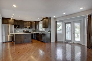 Photo 3: 93 Sidon Crescent SW in Calgary: Signal Hill Detached for sale : MLS®# A1150956