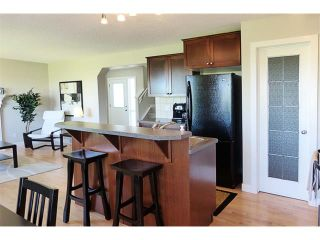 Photo 11: 772 LUXSTONE Landing SW: Airdrie House for sale : MLS®# C4016201