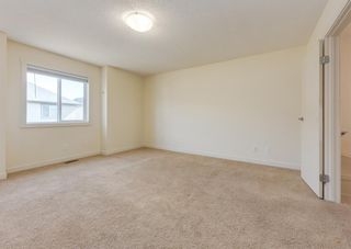 Photo 18: 402 2445 Kingsland Road SE: Airdrie Row/Townhouse for sale : MLS®# A1107683
