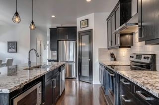 Photo 11: 615 50 Avenue SW in Calgary: Windsor Park Semi Detached for sale : MLS®# A1099934