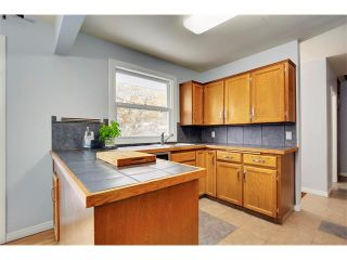 Photo 8: 4032 GROVE HILL Road SW in Calgary: Glendale House for sale : MLS®# C4088063
