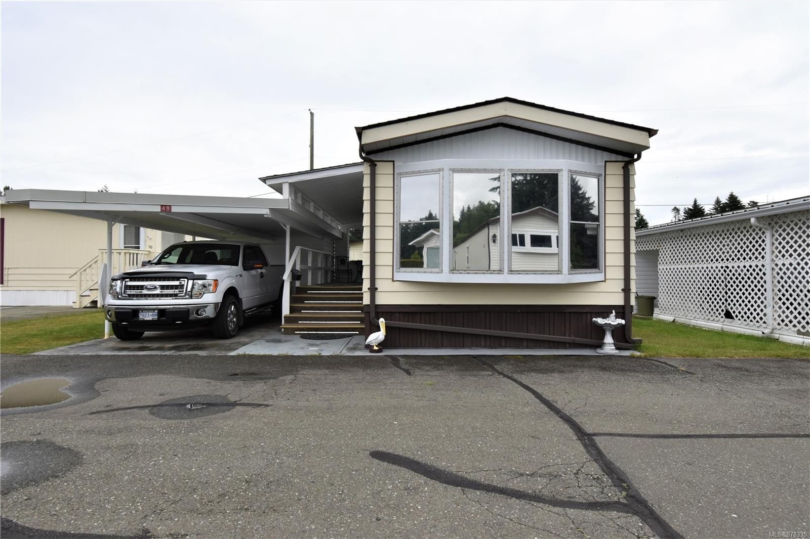 Main Photo: 49 1240 Wilkinson Rd in : CV Comox Peninsula Manufactured Home for sale (Comox Valley)  : MLS®# 878335