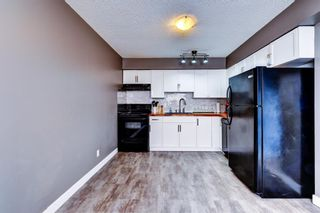 Photo 9: 1 6144 Bowness Road NW in Calgary: Bowness Row/Townhouse for sale : MLS®# A1077373